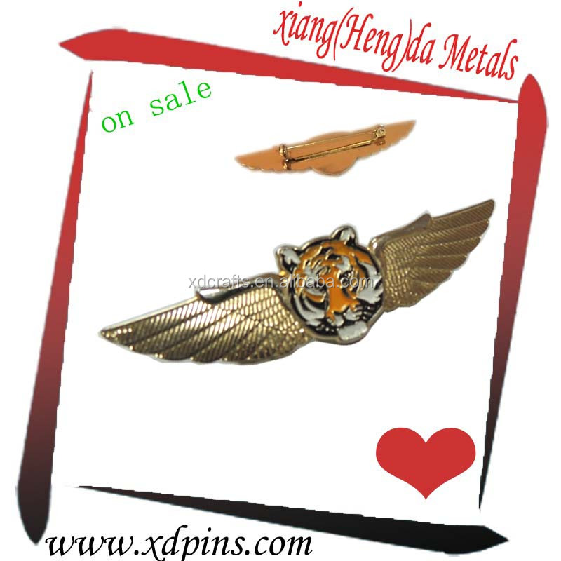brass plated tiger wing emblem