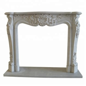 White marble French style stone fireplace surround mantel