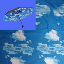 Umbrellas or umbrella fabric printed with blue sky and white cloud