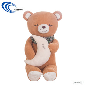 Brown cute plush teddy bear with moon