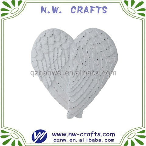 Custom white angel wings heart shape sculpture
