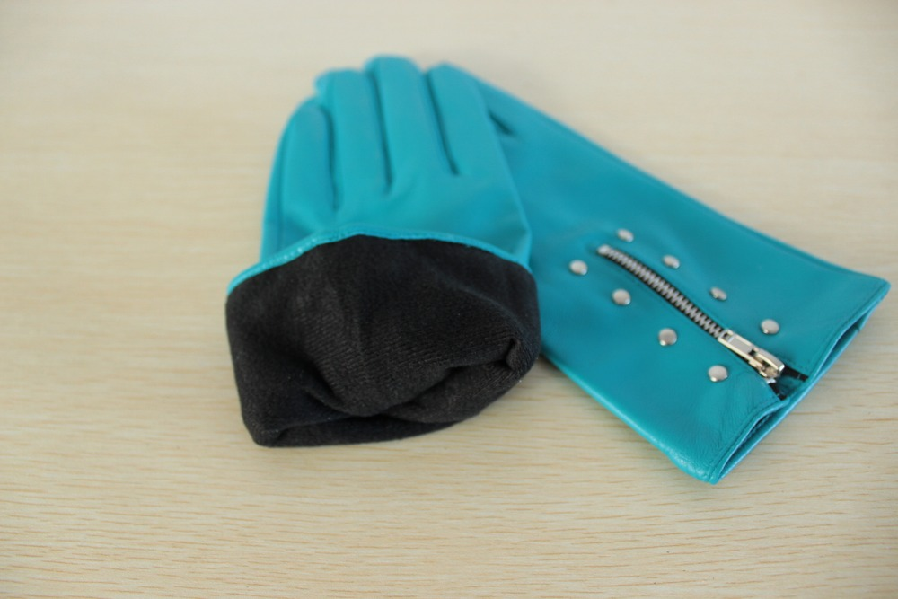 Women wear sky blue leather gloves with zipper and studs