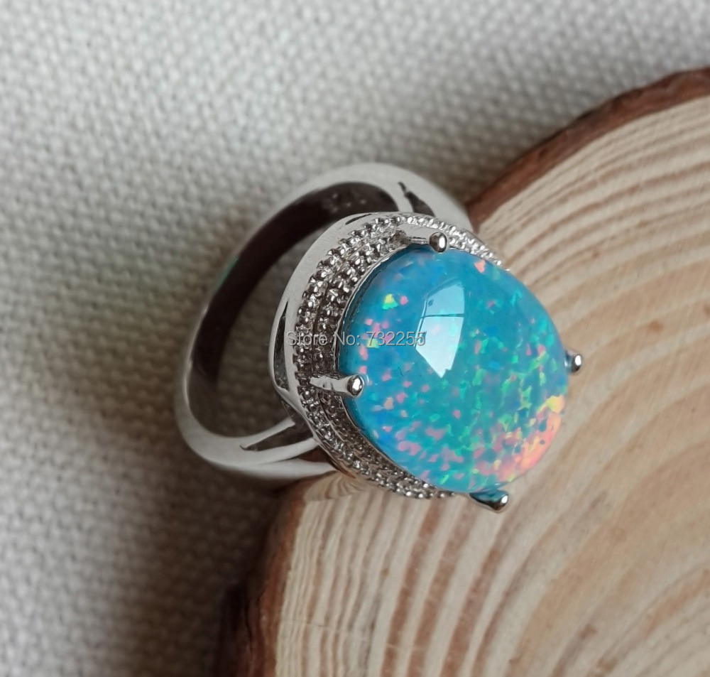 Cool big blue fire opal stone ring for men-in Rings from ...  Cool big blue f...