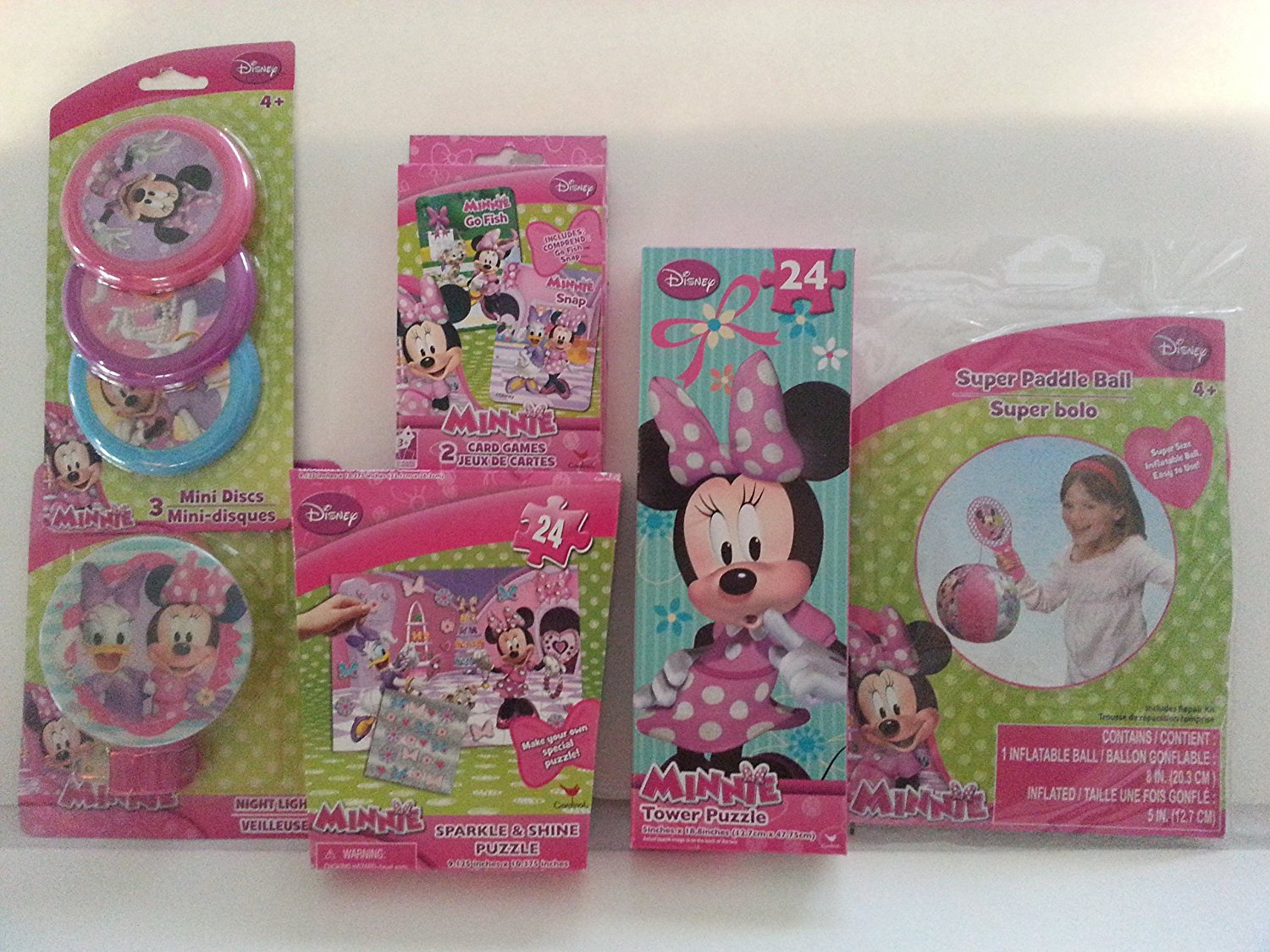 Disney Minnie Mouse Gift Set. Gift Bag Includes 1 (24) Pc Tower Puzzle, 1 Super Paddle Ball, 1 Sparkle Shine (24) Pc Puzzle, 1 Night Lights 1 Mini Disc (3) Pack Set, (2) Pack Card Game.