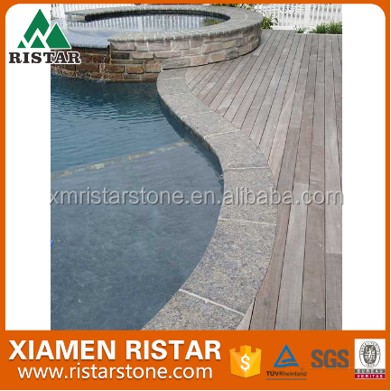 Natural stone swimming pool border in granite