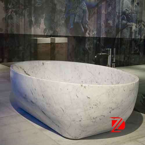 white artificial stone bathtub