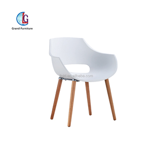 four wooden legs white plastic seat ball chair