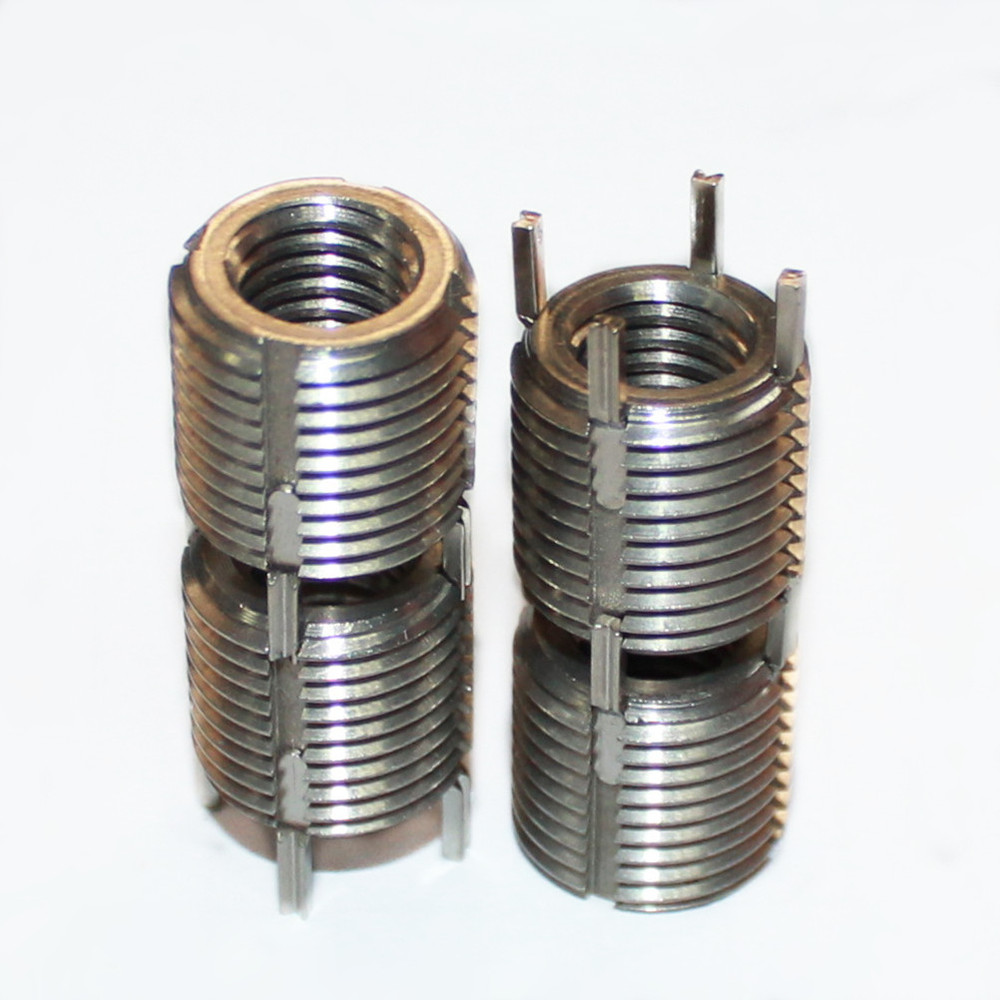 Carbon steel thread inserts for damaged aluminum screw