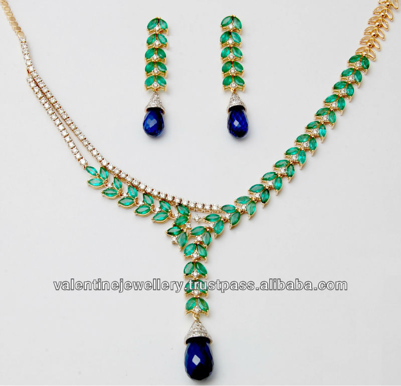 Source Marquise stone emerald and sapphire drop gold
