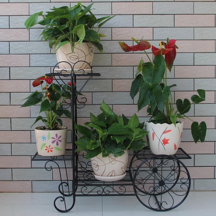v lo en m tal porte pot de fleur en fer forg pots. Black Bedroom Furniture Sets. Home Design Ideas