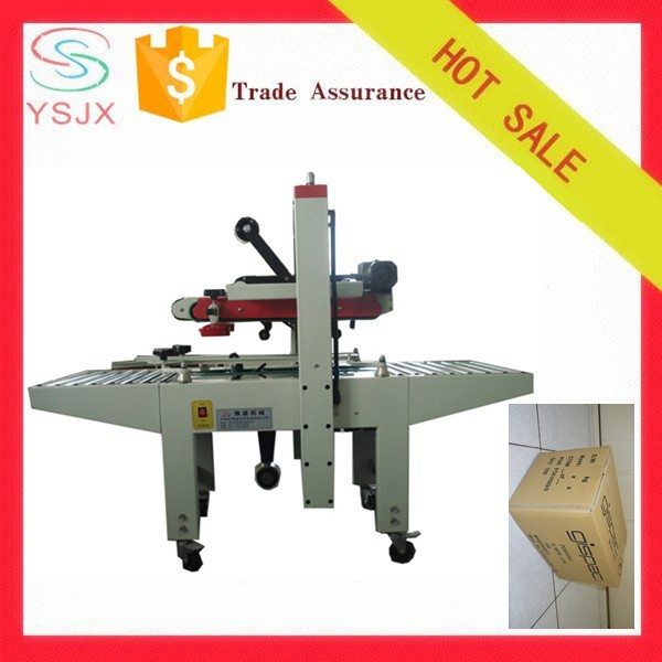 Adhering paper box sealing machine