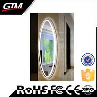 Customized oval touch screen bathroom mirror with light with shelf with waterproof function