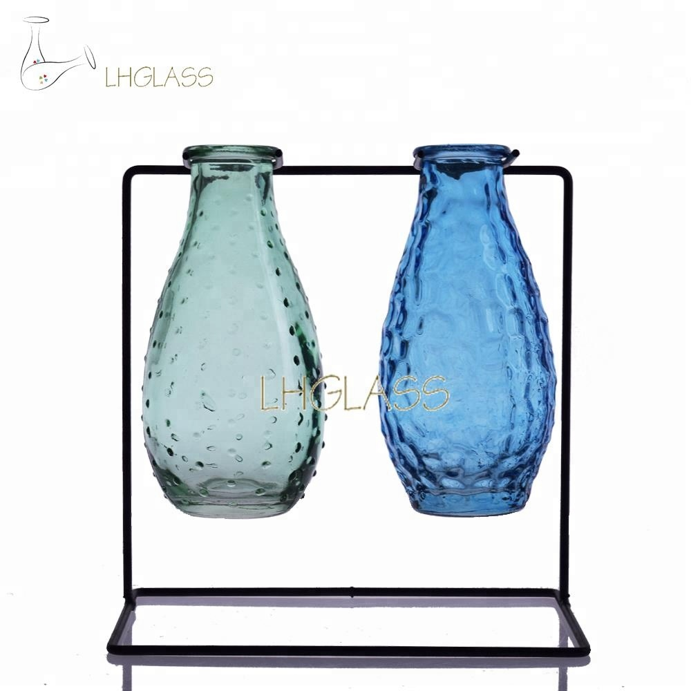 74393d3ca4b Small Bud Glass Vases In Black Metal Rack Stand