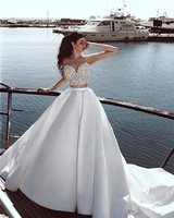 2019 Sexy Illusion Long Sleeve Wedding Dresses Two Pieces Beach Wedding Gowns Applique Lace Top Satin Skirt Modern Bridal