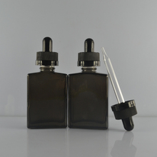 Wholesale 30ml black frosted rectangle rectangular glass dropper bottle for essential oil e liquid with packaging box
