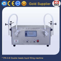 Guangzhou factory double heads vegetable oil / water bag / tea bag filling machine