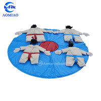 Kid and adult fighting padded fat sumo wrestling suit with arena