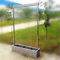 Artificial waterfall in clear glass panel with led light