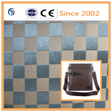 pvc foaming jacquard 100% polyester grid on the grade for business bag