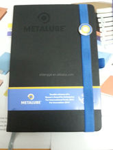 sample of hardcover notebook with elastic band and badge