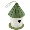 Small painting green and white color wood bird house with rope
