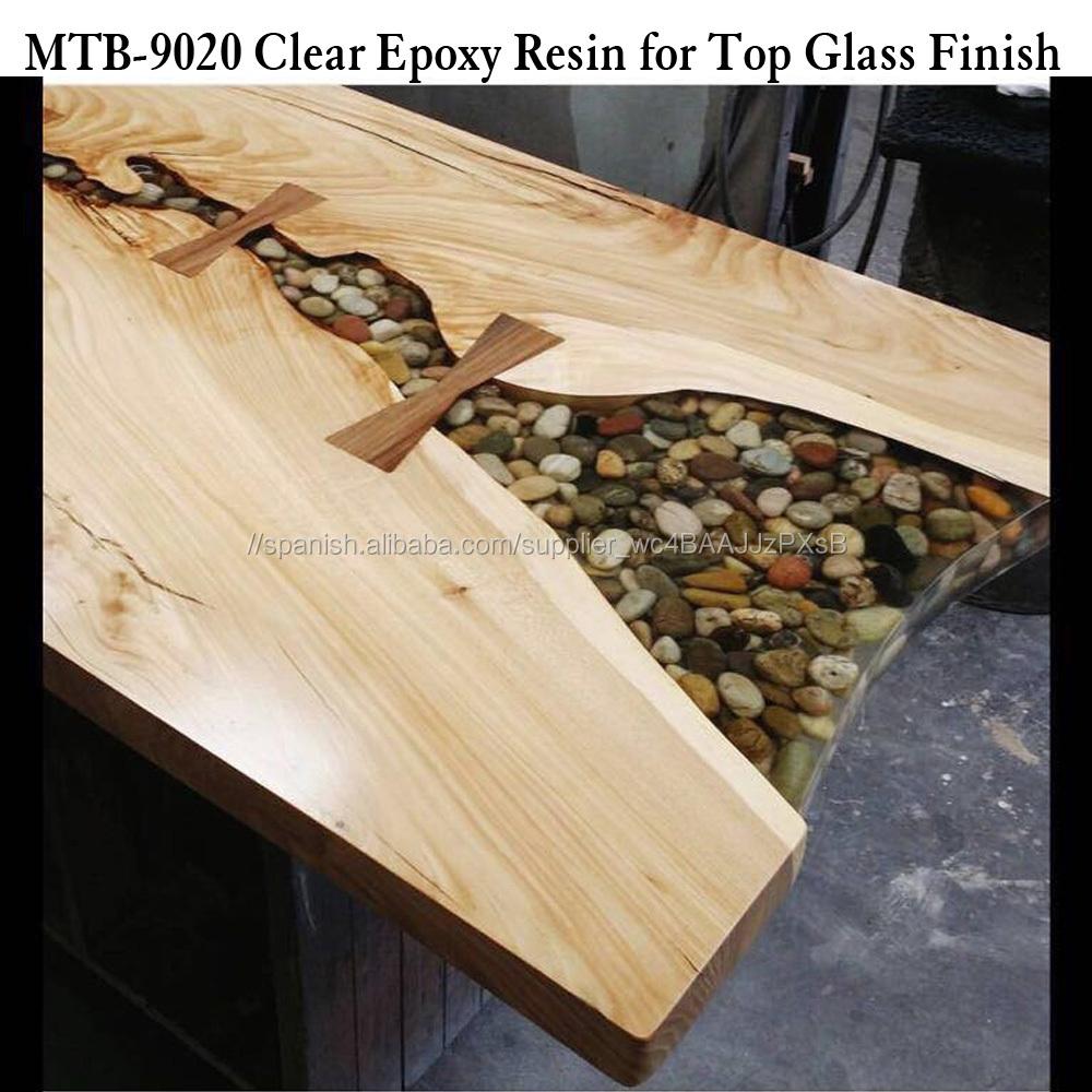 Mesa de madera capa de acabado final de cristal de resina for Resina epoxi madera