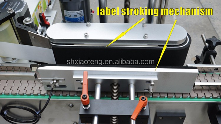 label stroking mechanism