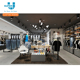 Retail Custom Name Brand Design Modern Merchandising Fixture For Retail Clothing Store