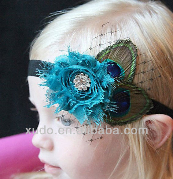 cabritos de la manera del tocado de plumas de pavo real diadema en stock