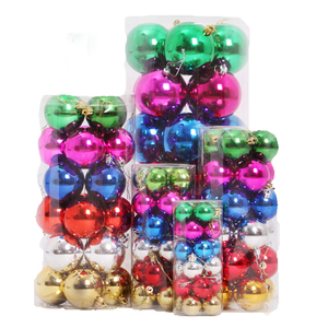 Small white and green Christmas tree decorations glass balls