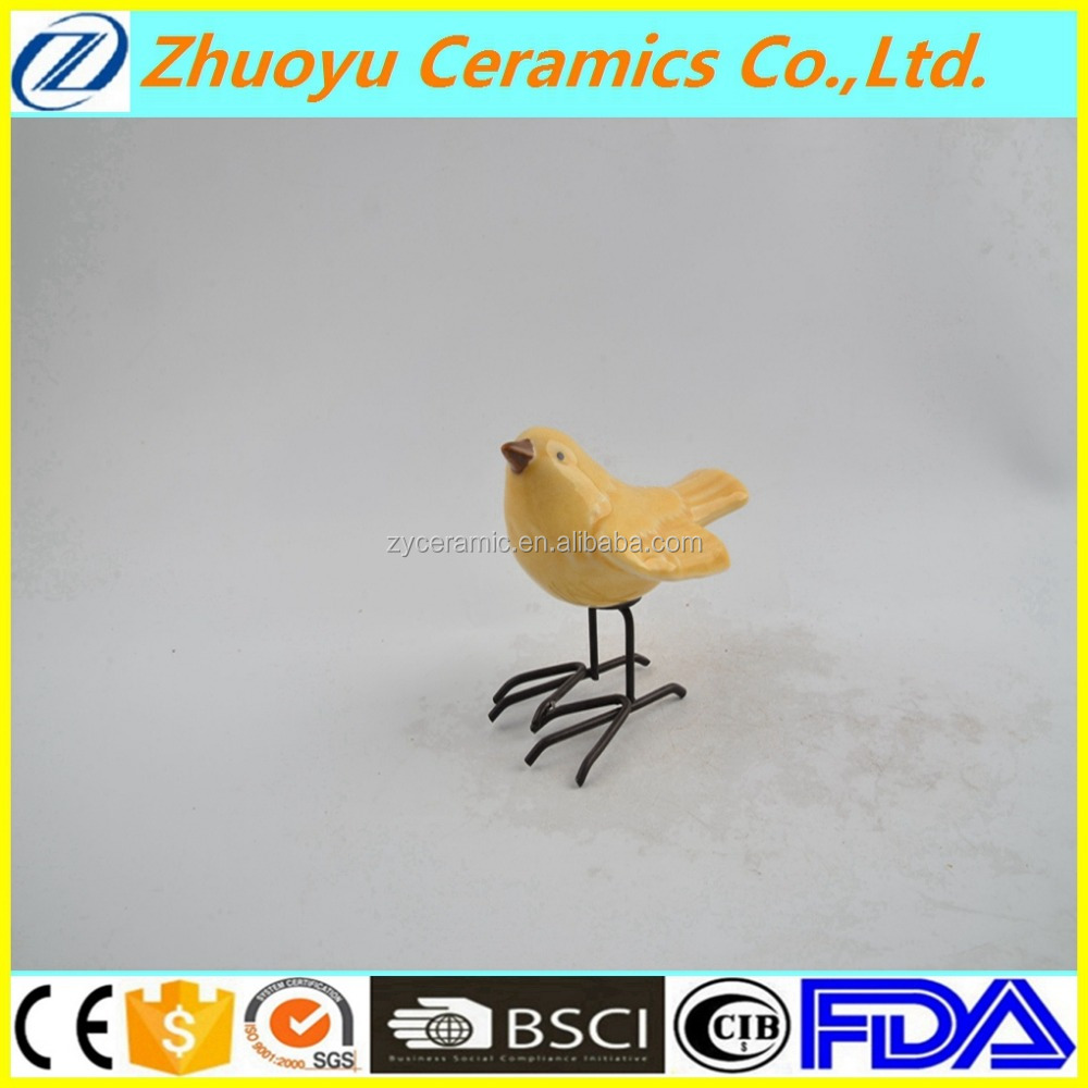 Spreading wings yellow ceramic bird with iron feet
