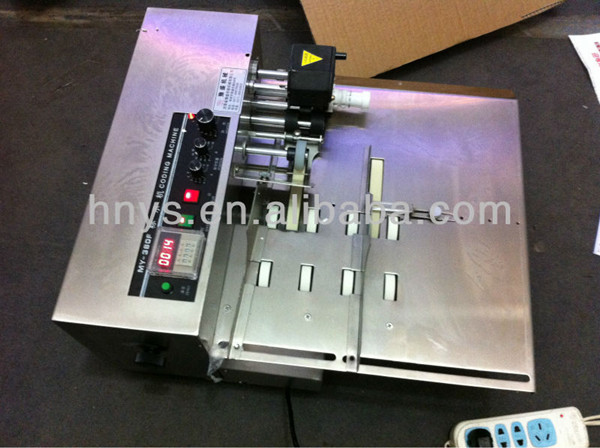 Hand operated solid ink date batch coding printing machine