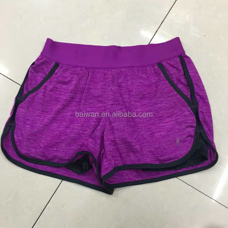 China garment stock lot factory price women cheap gym shorts