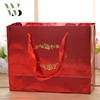 /product-detail/hot-stamping-embossing-red-art-paper-bag-for-wedding-gift-packaging-with-ribbon-handle-60830884233.html
