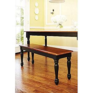 Autumn Lane Farmhouse Bench, Black and Oak Mix of stained oak and painted black finishes Turned wood legs and back with Solid wood seat Product Dimensions (L x W x H): 48.00 x 14.00 x 18.00 Inches