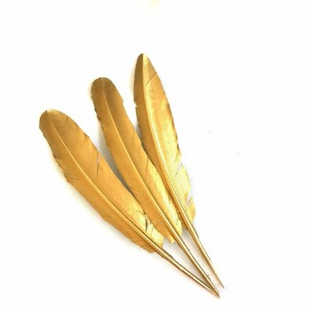 painted golden turkey feather party and wedding decoration
