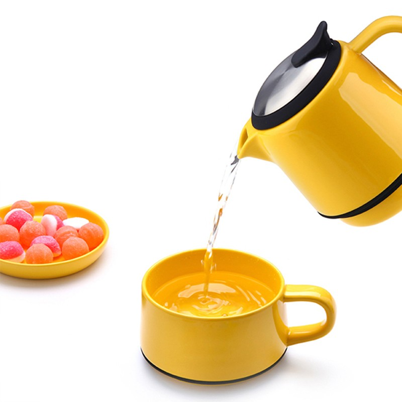 yellow tea for one stump teapot with stackable flip top teapot with handy arm