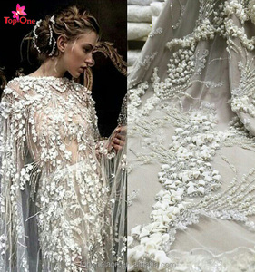 China manufacturer wholesale high quality white hand beaded lace fabric 3d lace fabric french lace