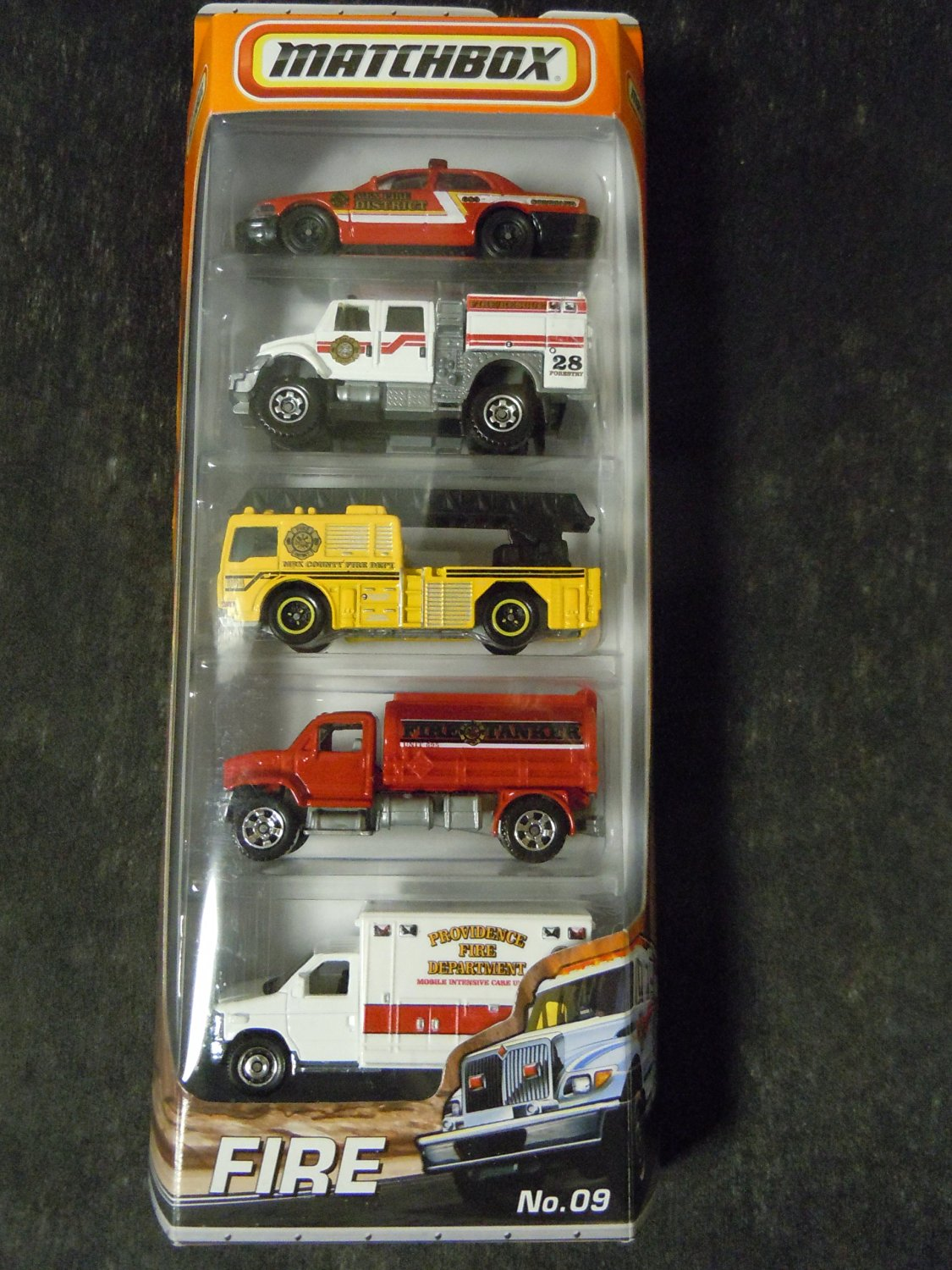 2010-2011 MATCHBOX 5 PACK, FIRE cars #9: Ford Crown Victoria, International WorkStar Brush Fire Truck, Fire Engine, MBX Tanker, Ford E-350 Ambulance