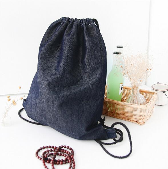 35de6d7ed1 Get Quotations · 2015 fashion women escolar denim backpack travel softback  man mochila feminina drawstring school bag for teenage
