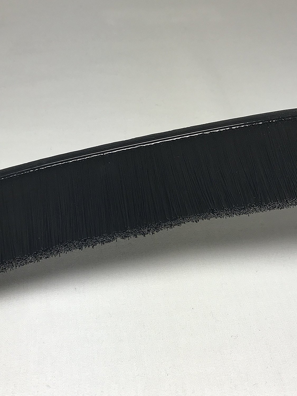 "Flexible Nylon Strip Brush. Width 1/4""(1mm) . Height Backing 3/1""(0.1mm). Overall Height 2""(50.8mm). Bristle Diameter 0.010""(0.25mm). Order Per Foot."