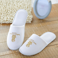 white velvet close toe hotel slipper with embroidery