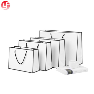 New hot sell custom paper gift white card bags with your logo printed and nylon handles