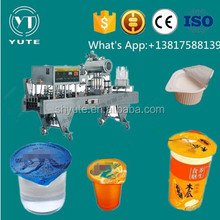 Instant coffee cup cake filling and sealing machine