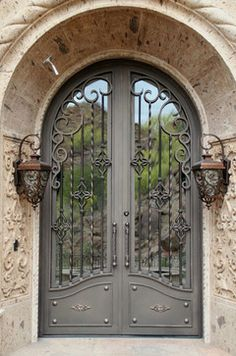 Merlin rustic round top wrought iron exterior entry doors
