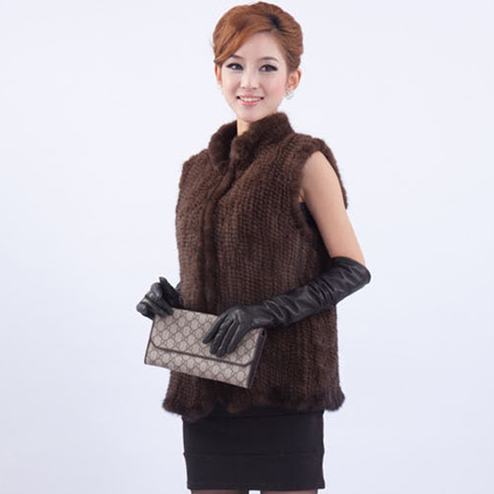 Beautiful black rabbit fur women's 2X vest. Zipper is top down &/or bottom up. Ribbed collar, armholes, and waist. I think this is a vintage vest, it doesn't really look like a 2x, please check measurements.