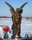 Large bronze grave angel for sale with flowers