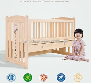 Customized Multifunctional solid wooden cot bed baby cribs with storage drawers changing into study table and sofa