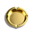 gold color round metal ashtray