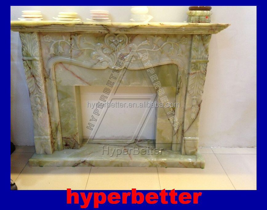 Magic green onyx fireplace with carvings.